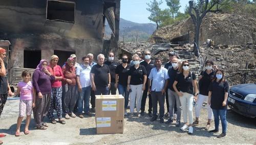 Başkan Özgan, hayırsever iş insanlarıyla yangın mağdurlarına yardım malzemesi dağıttı
